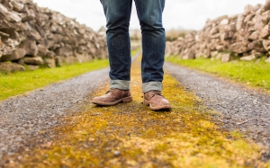 man-with-boots-in-dirt-road