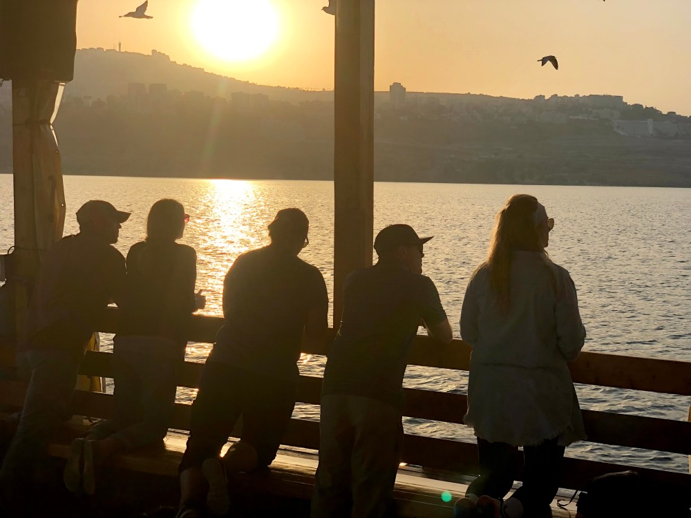 galilee-sunset-people-by-rail-